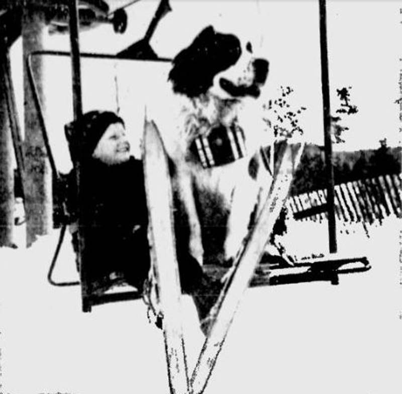 Calvin Dearborn and St. Bernard Suzie on the double chairlift circa 1969